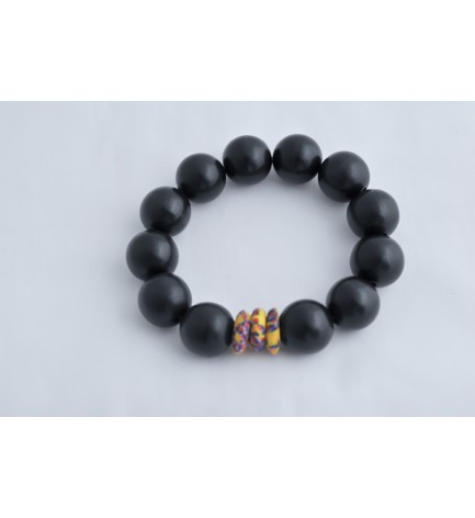 Adzo Designs black wood beads with a multicolour krobo ghanian bead on stretch