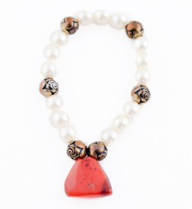 Pearl and coral pendant bracelet with bronze accents